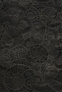 Carbon Cantata -Ammonite Aria (linocut embossing with crushed metallurgical coal on sumi-tinted BFK Gray)